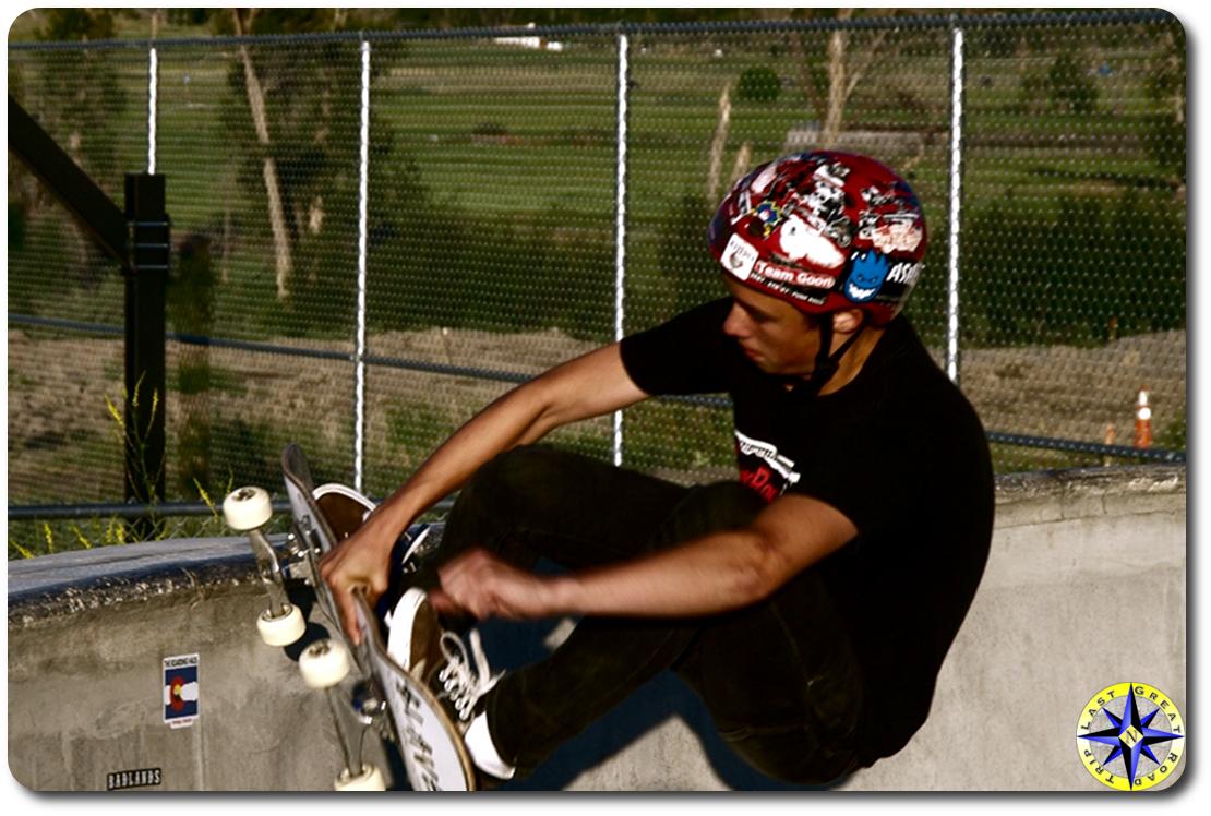 boy skateboarding pool