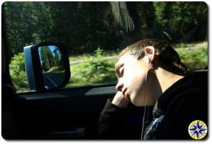 boy asleep in the passenger seat