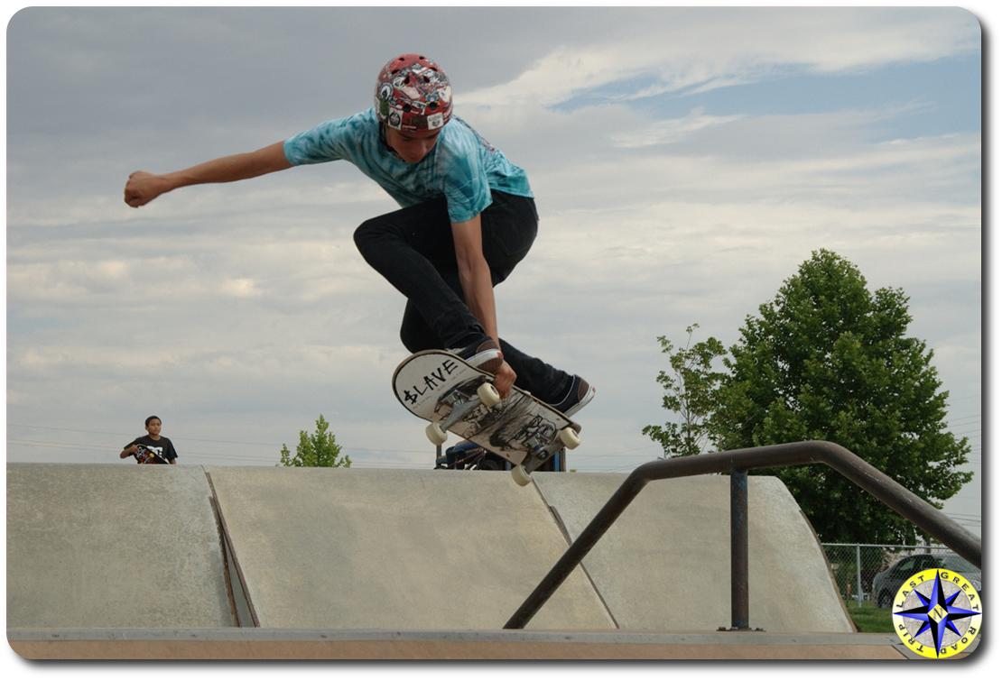 skateboard over rail