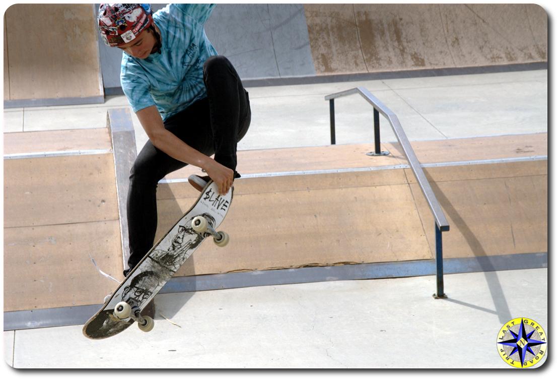 skateboarding grabbing board