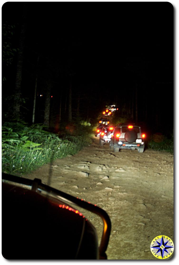 fj cruisers on 4x4 trail at night