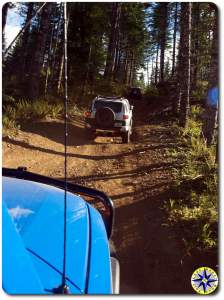 three fj cruiser hill climb in woods