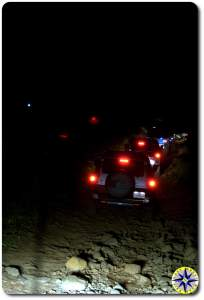 toyota fj cruisers tail lights on 4x4 trail at night