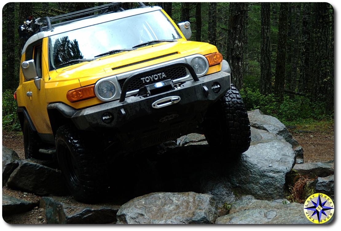 yellow fj cruiser rock crawl