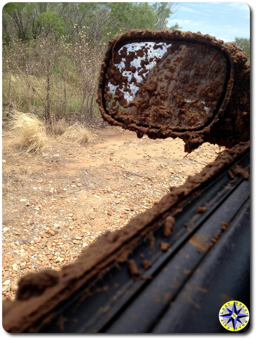 mud covered jeep mirror