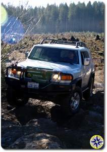 fj cruiser approaching rocks tahya forest