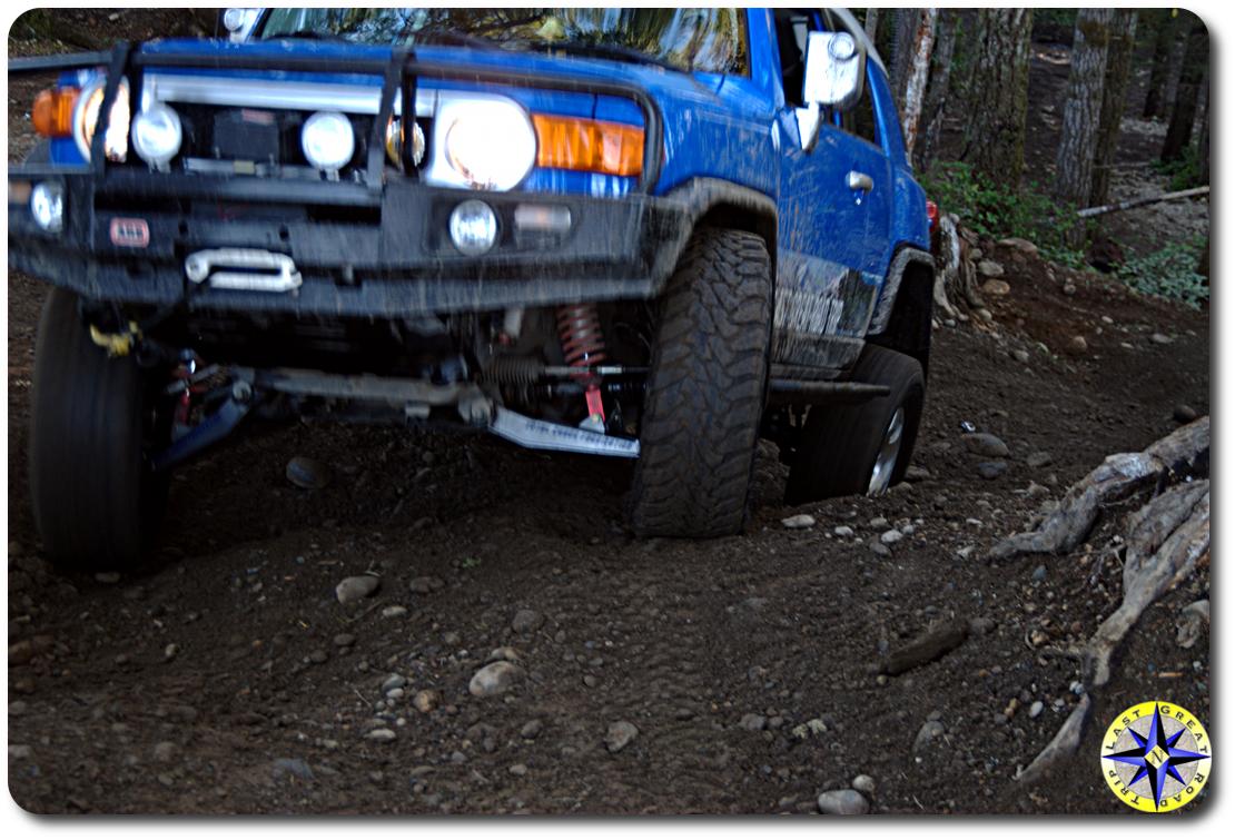voodoo blue toyota fj cruiser climbing hill
