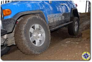 close up fj cruiser lifting rear wheel 4x4 trail