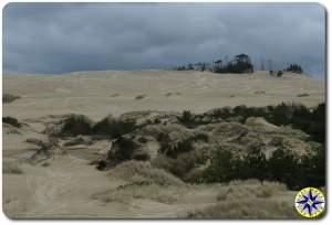 dark clouds florence sand dunes