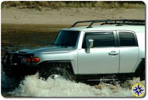silver fj cruiser fording water