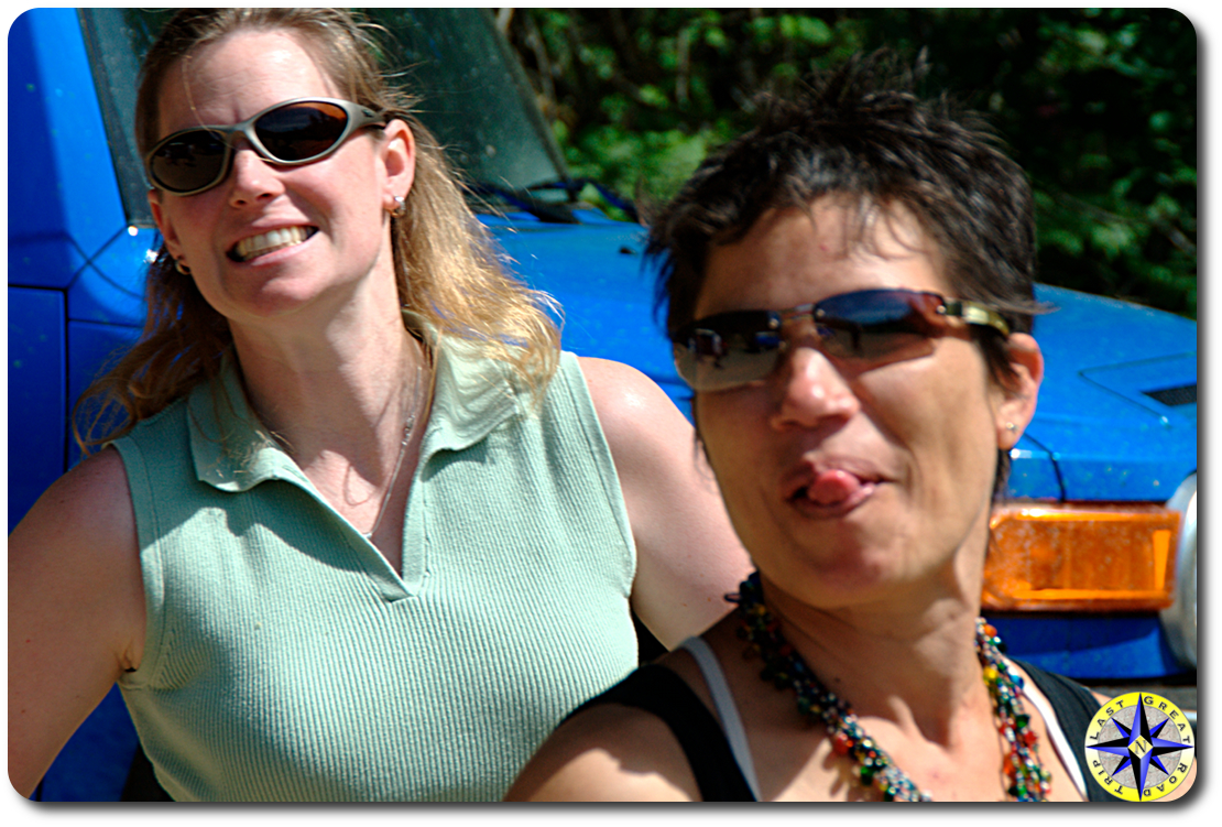 women smiling and sticking tongue out