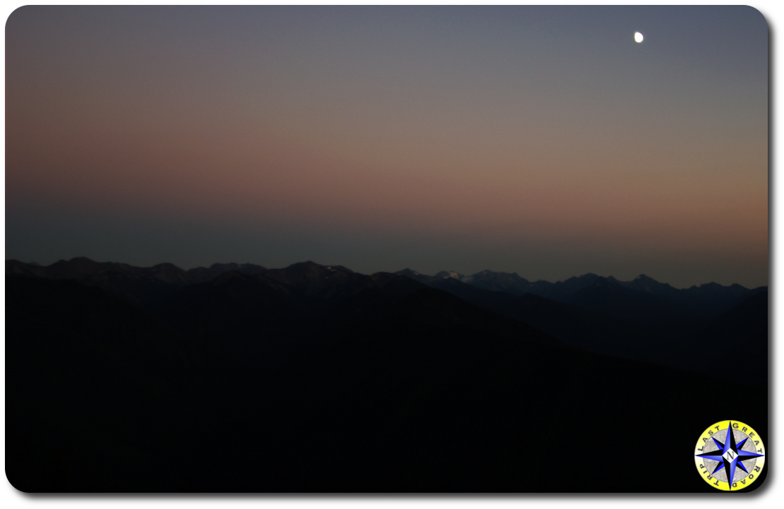 sunset with moon over olympic mountains