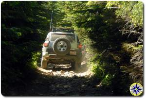 silver fj cruiser tight 4x4 trail