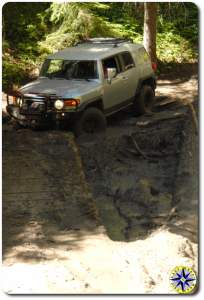 silver fj cruiser bridge over mud pit