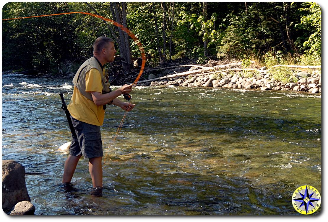 man fly fishing river