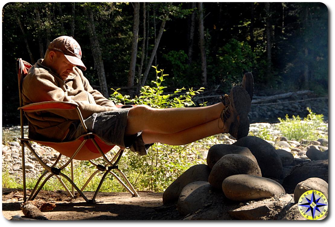 man sleeping camp chair morning sun