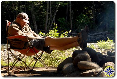 man sleeping camp chair morning sun