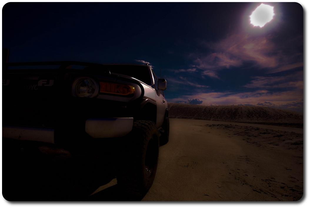 silver fj cruiser sandy desert road