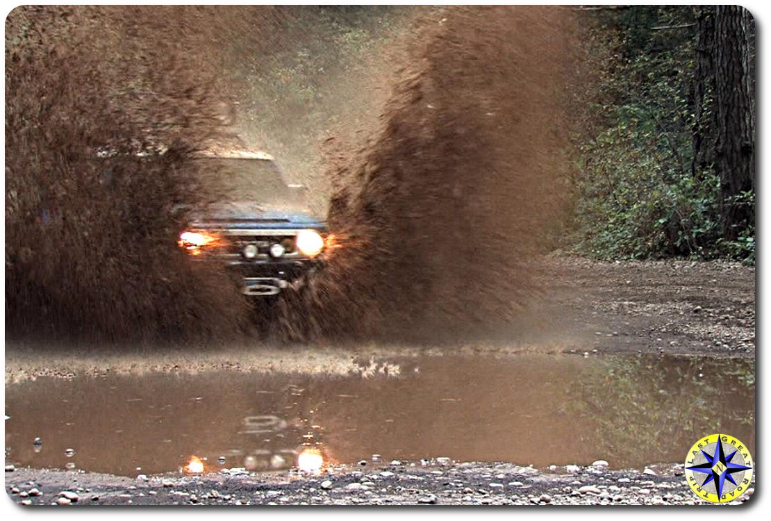 Toyota fj cruiser splashing muddy water