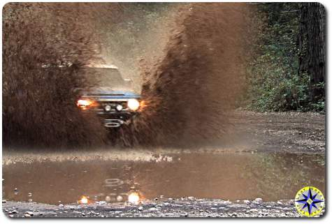 Toyota fj cruiser splashing muddy water