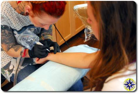 woman tattoo artist at work