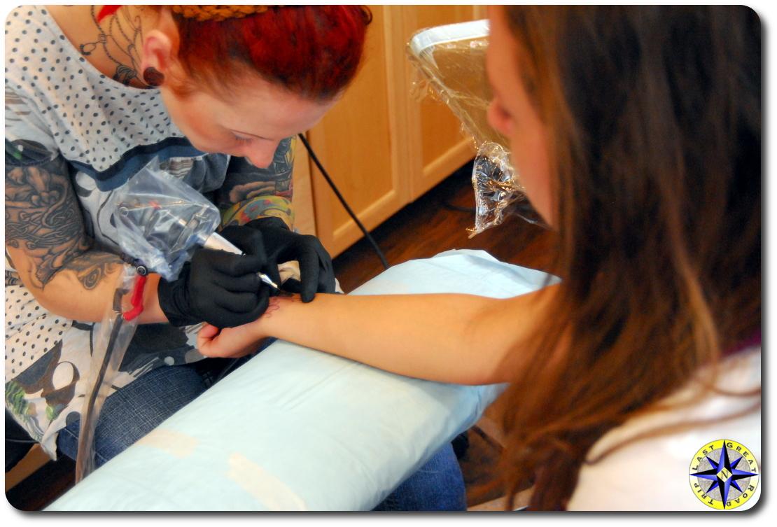 woman tattoo artist at work