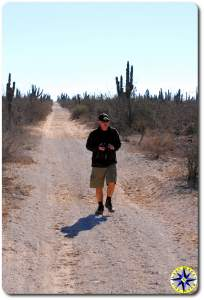 Man walking baja dirt road