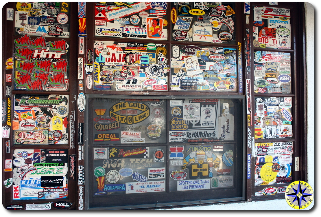 stickers covered window at mikes sky rancho