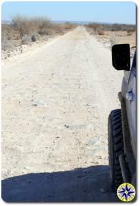 long straight dirt road fj cruiser baja mexico