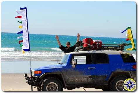 man fj cruiser baja mexico pacific ocean beach prayer flags