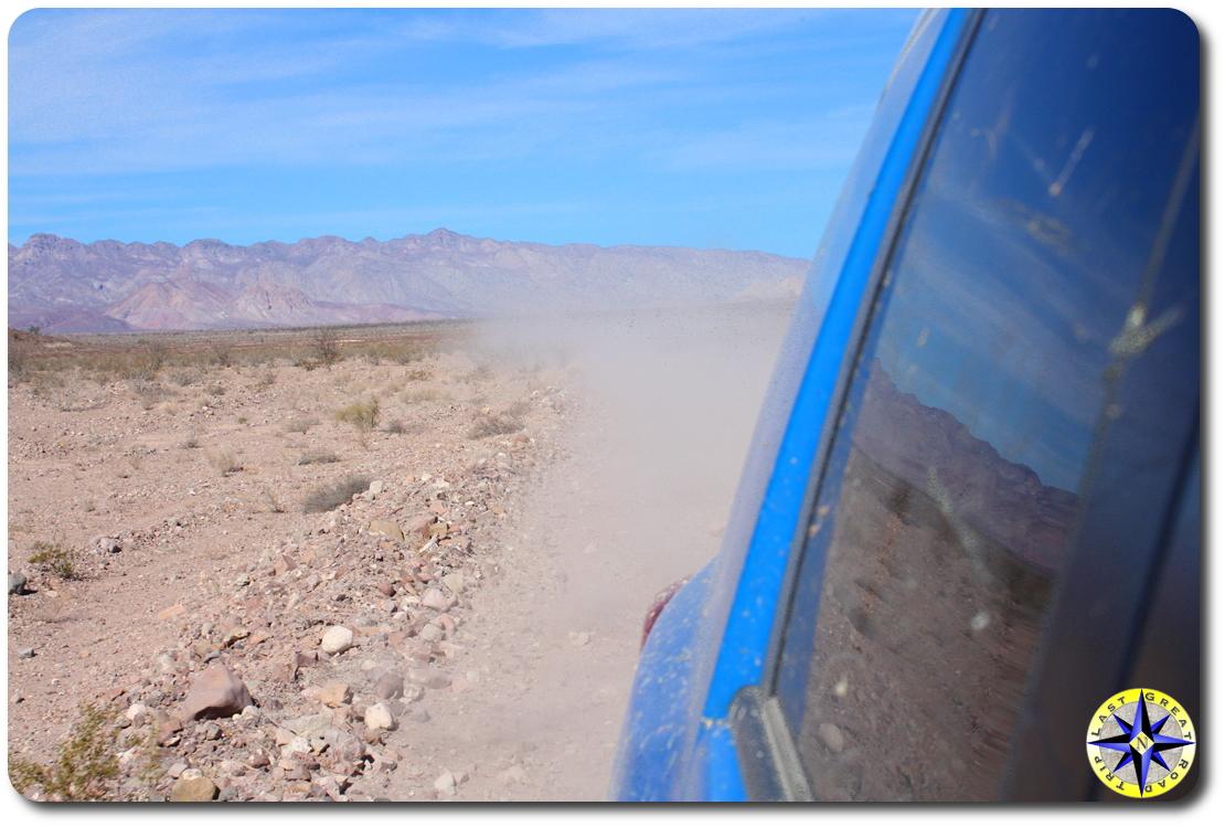 dusty road behind fj cruiser