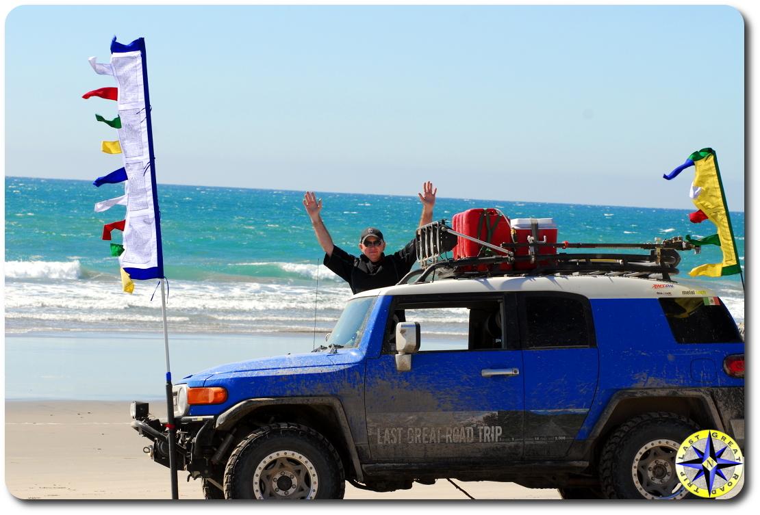 man fj cruiser baja mexico pacific ocean beach prayer flags