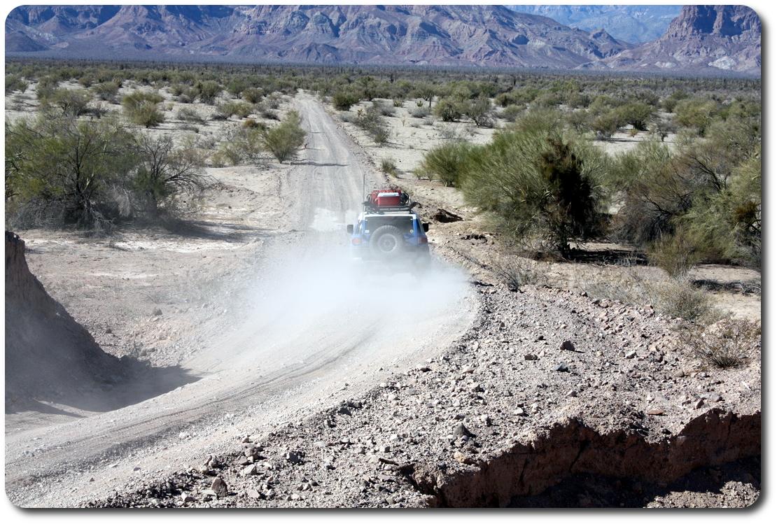 fj cruiser driving away baja road