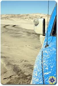fj cruiser tire track in beach sand