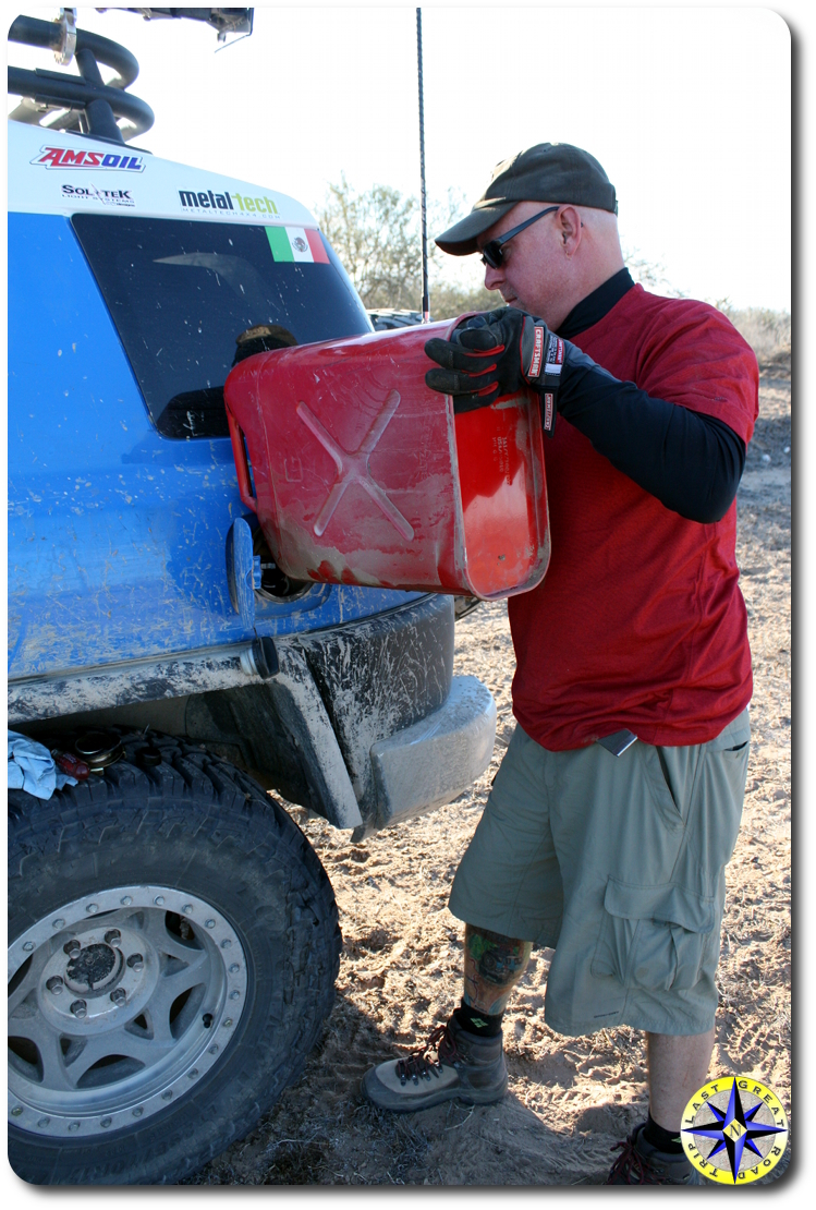 man adding gas from jerry can to fj cruiser