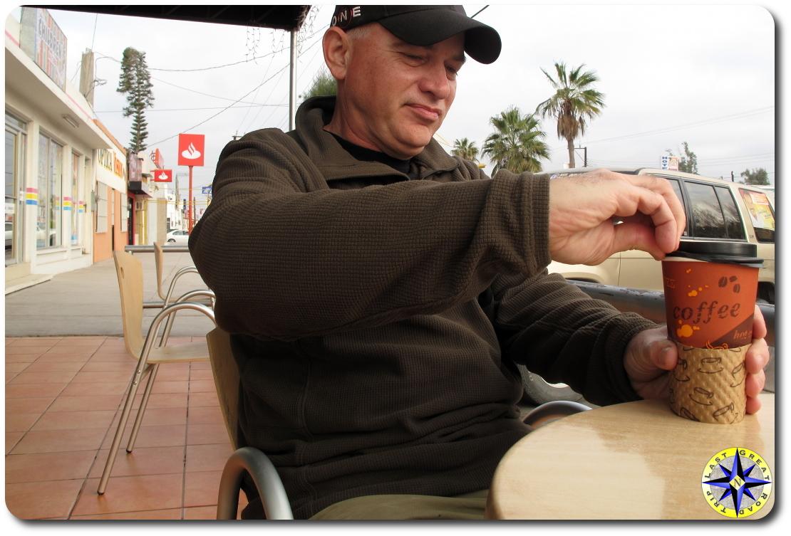 man opening coffey lid baja mexico cafe