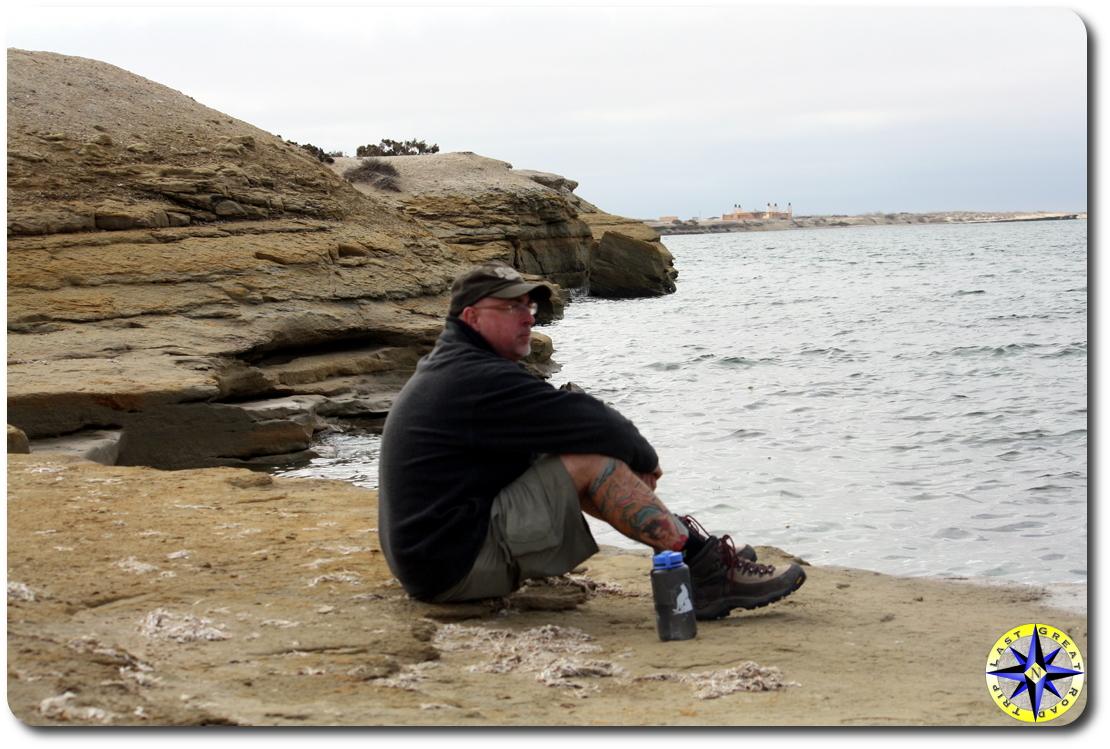 man tattoo sitting scorpian bay baja mexico