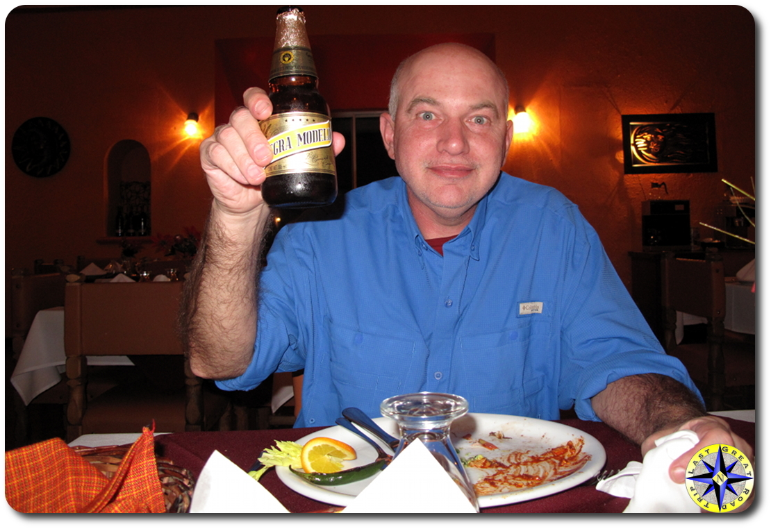 man toasting with negra modelo beer