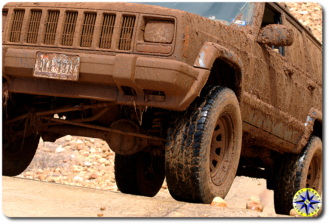 muddy jeep on incline