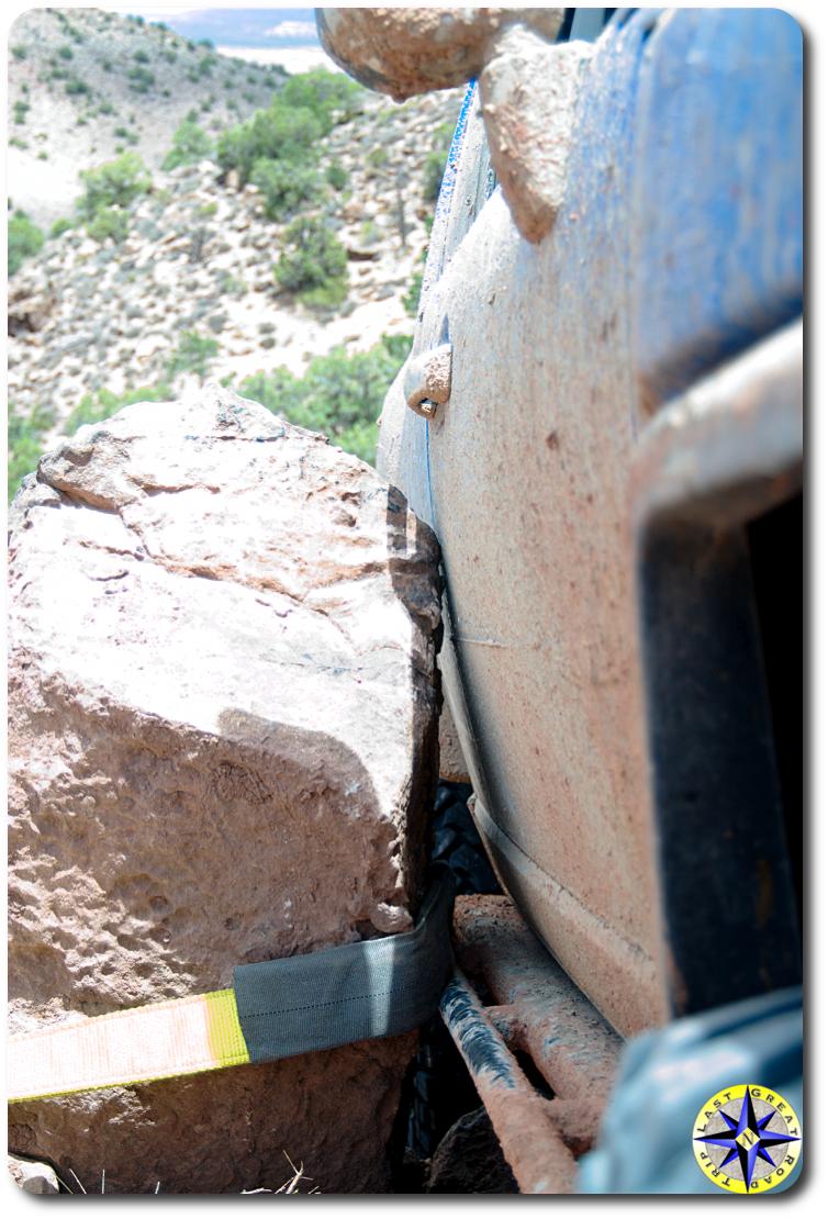 4x4 stuck against rock