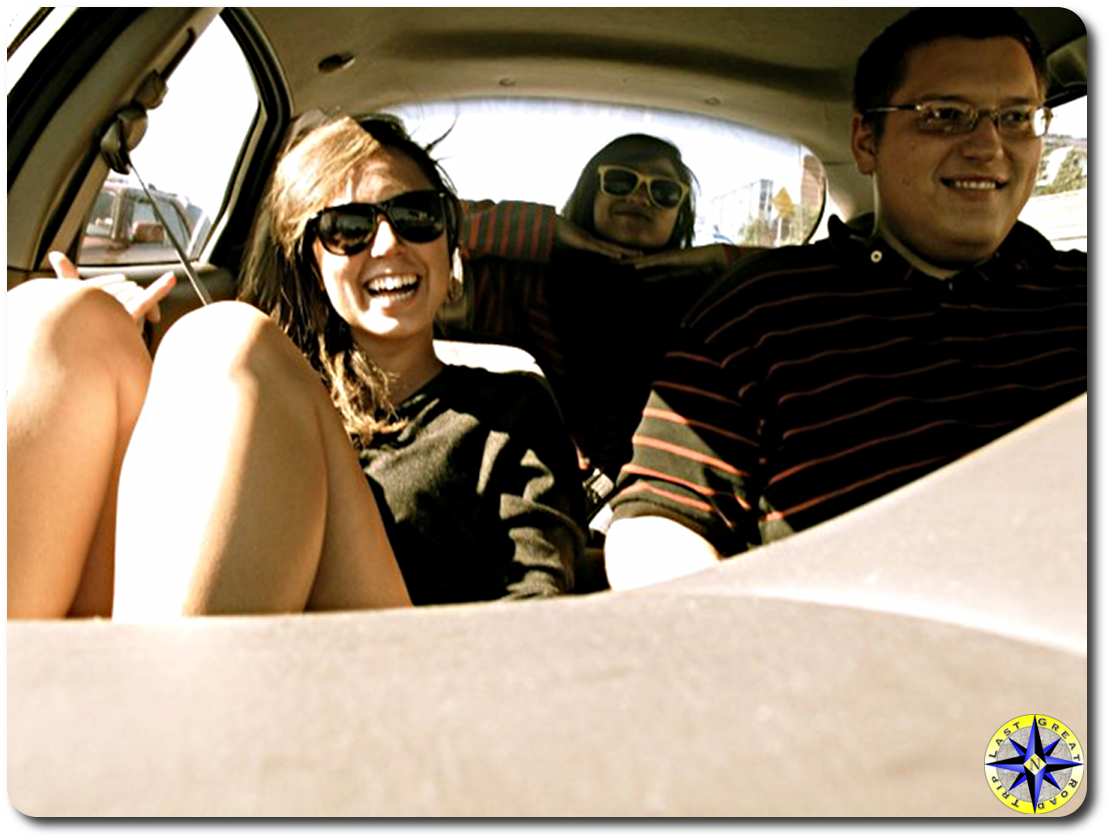 three college friends in car road trip