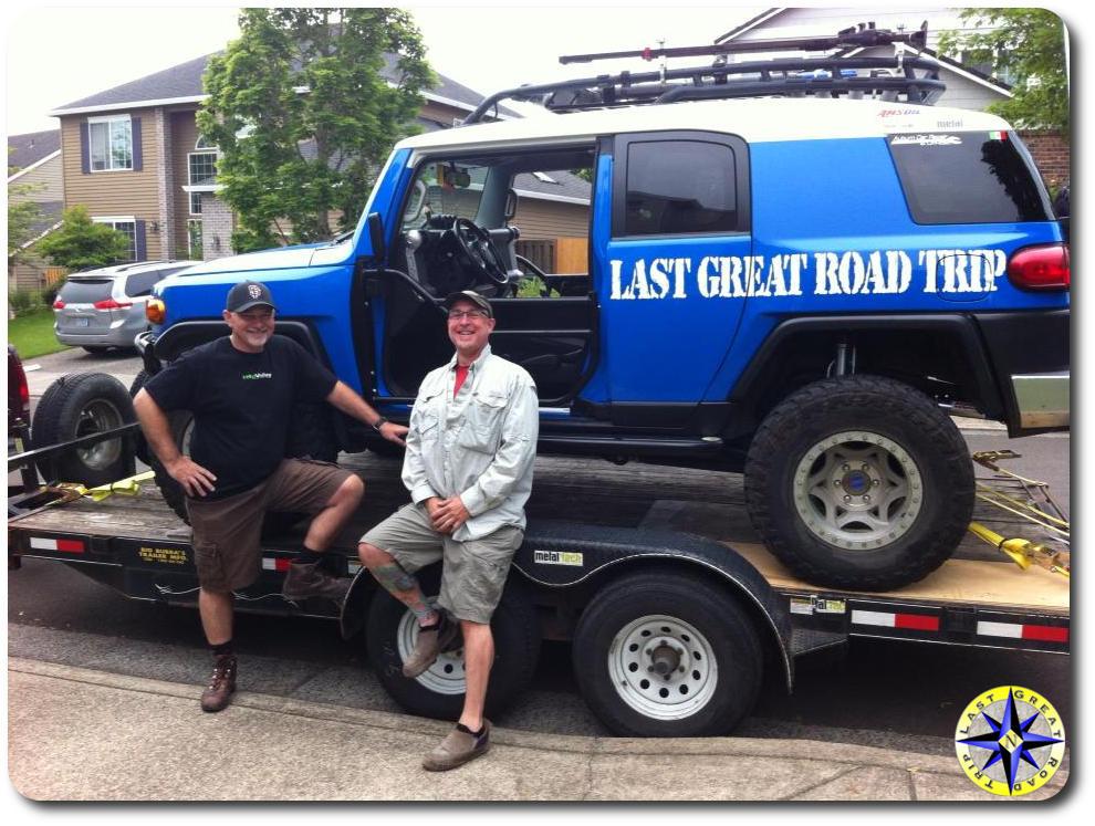 two men ultimate fj cruiser on trailer