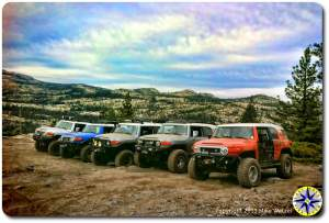 fj cruisers lined up on rubicon trail