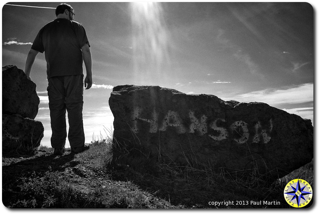 man standing next to hanson rock