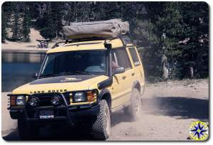 yellow land rover discovery