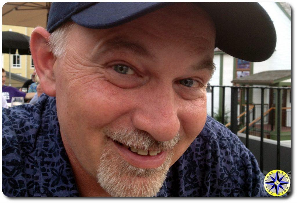 Brad man with ball cap smiling