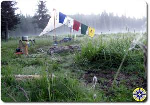 sunrise camp prayer flags minimalist primitive camping
