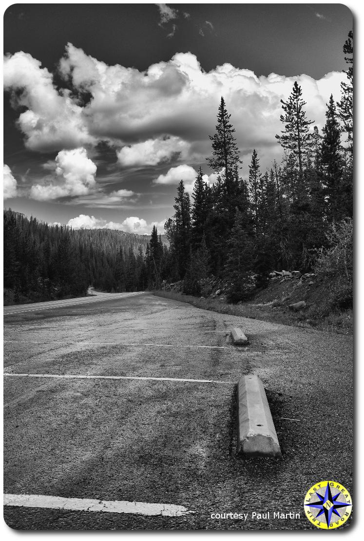 Storm clouds over utah mountain rest stop parkin lot