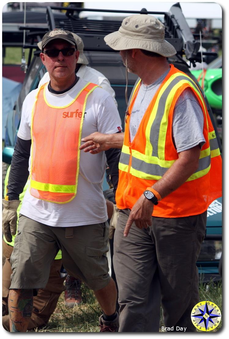 men in safety vests