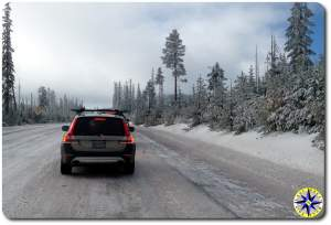 volvo driving snowy pass